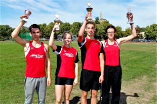 Die vier Siegerpokale in Melsunger Hand - Marvin Knaust (Männer), Vivian Groppe (Schülerinnen), Jan Gille (Schüler) und Luise Zieba (Frauen). Foto: nh